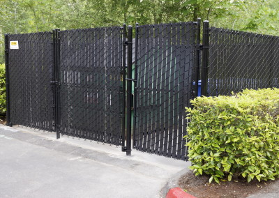 Chainlink Fence around Garbage Dumpsters