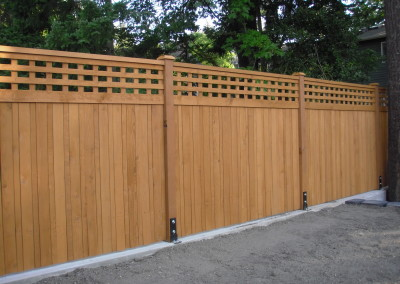 cedar fence attached to concrete